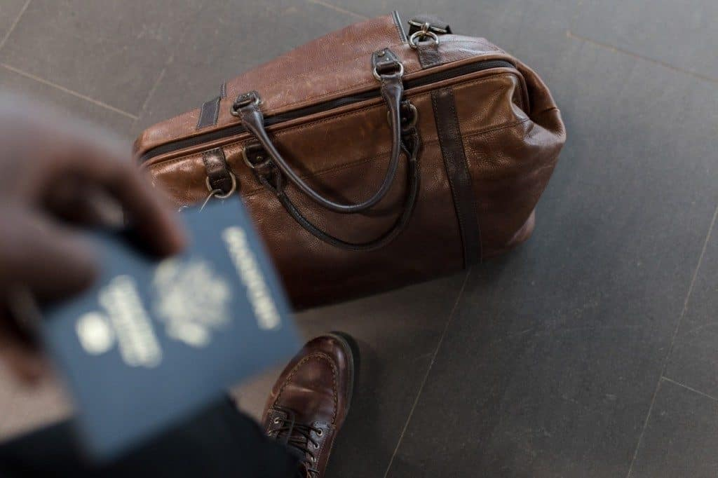 Man holding passport in airport