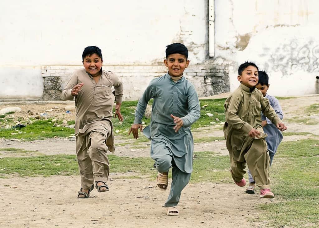 Children running towards the camera in Pakistan