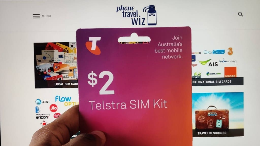Adu from Phone Travel Wiz holding a Telstra SIM Card