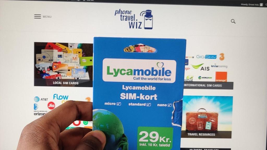 Adu from Phone Travel Wiz holding a Lycamobile Denmark SIM Card