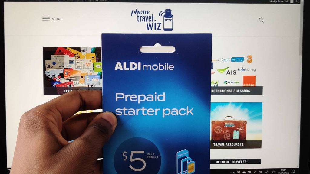 Adu from Phone Travel Wiz holding an ALDImobile SIM Card