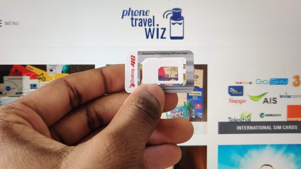 Adu from Phone Travel Wiz holding a Dialog SIM Card