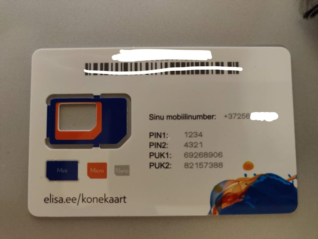 The back of an Elisa SIM card with important details