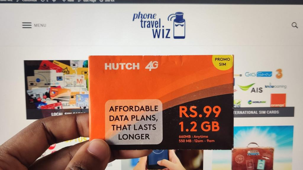 Adu from Phone Travel Wiz holding a Hutch SIM Card