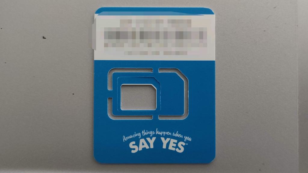 Adu from Phone Travel Wiz holding a Yes SIM Card