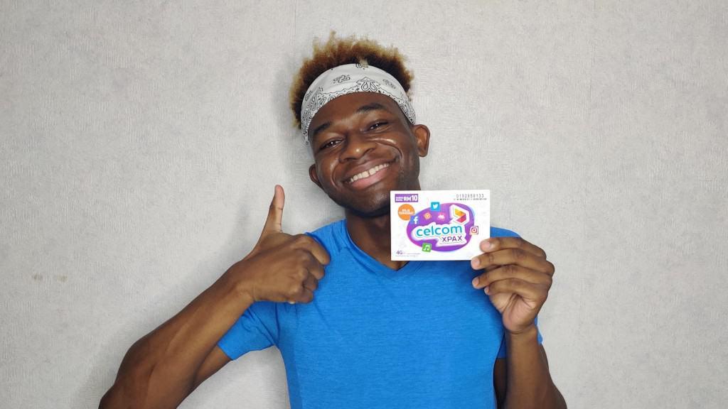 A happy Adu with his Celcom SIM card
