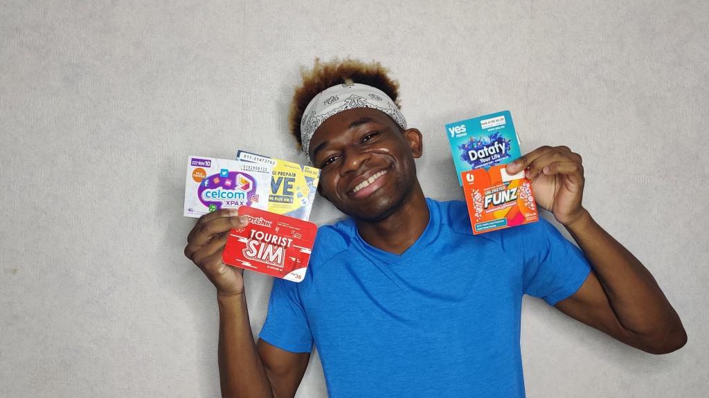 A happy Adu with his Malaysian SIM Cards
