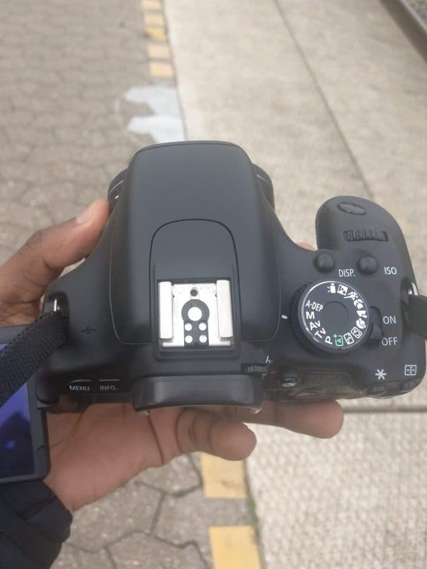 Ernest Adu holding a Canon 600D