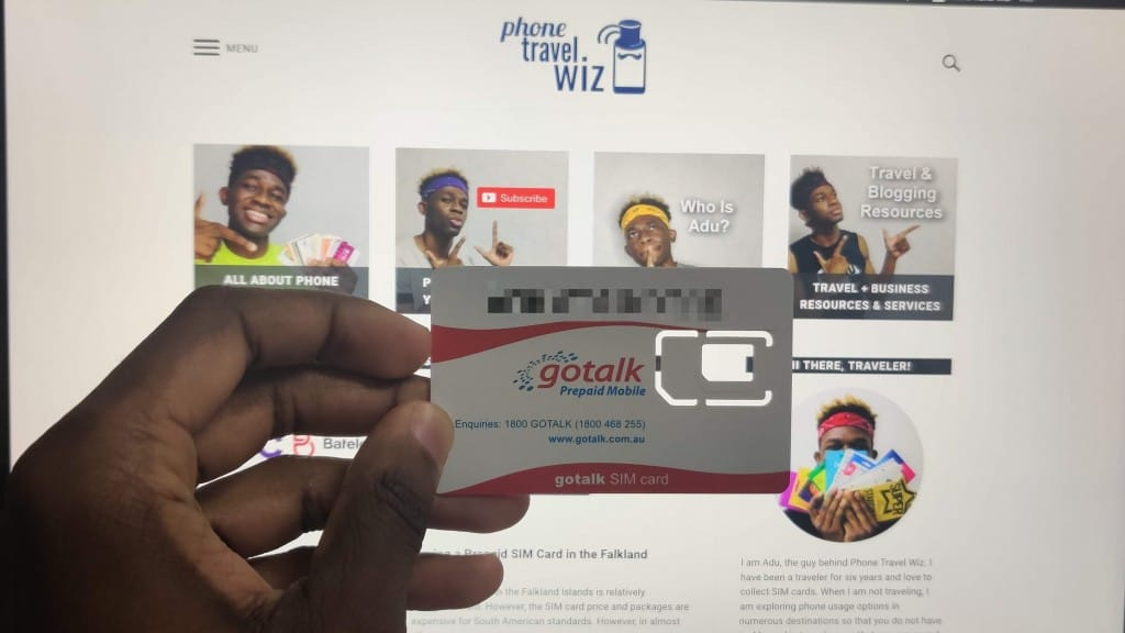 Gotalk SIM card held by Adu from Phone Travel Wiz
