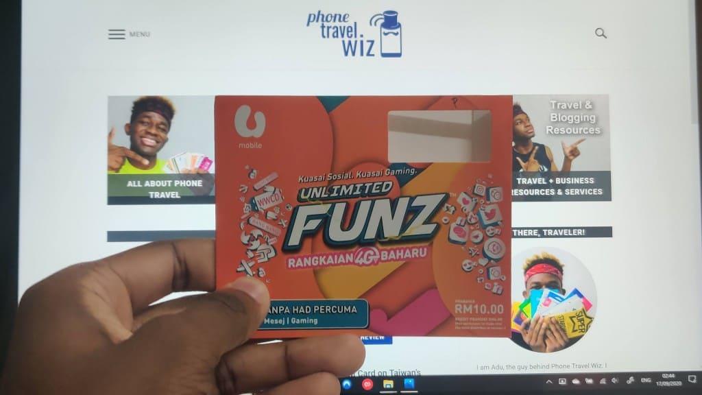 Adu from Phone Travel Wiz holding his U Mobile SIM Card