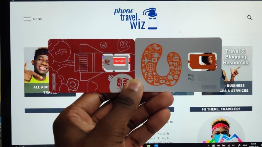 Adu from Phone Travel Wiz holding U Mobile and Hotlink SIM Cards